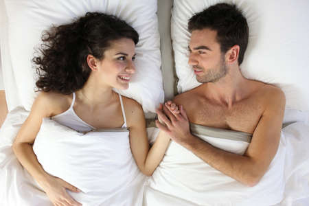 recovery position: Couple in bed