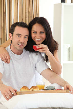 Couple having breakfast in bed Stock Photo - 14020852