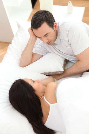 bedlinen: couple in bed talking Stock Photo