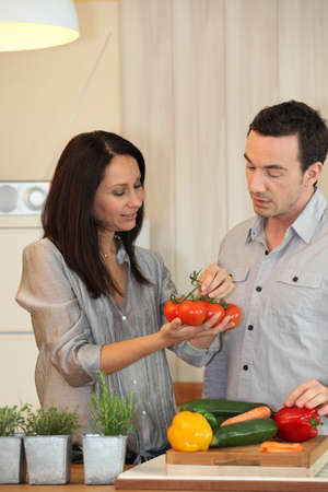 Couple debating which vegetables to cook photo