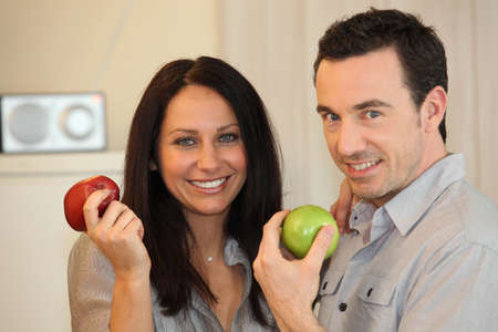 Couple eating apples photo