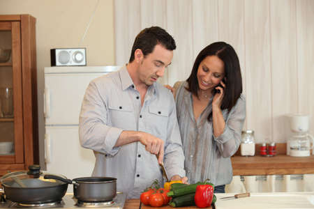Couple preparing a meal together photo