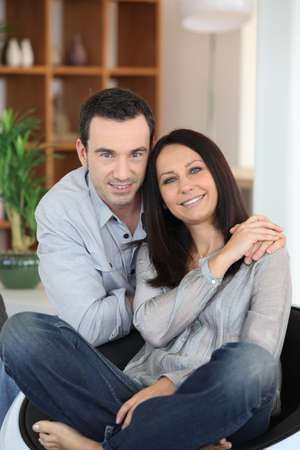portrait of young couple posing at home photo