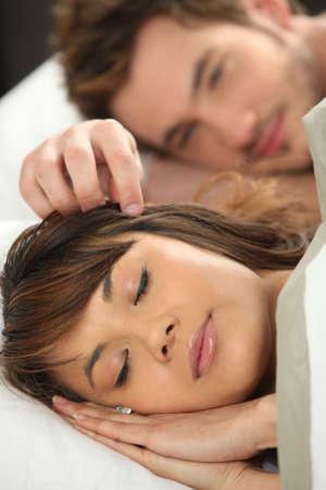 two stroke: Pareja en la cama Foto de archivo