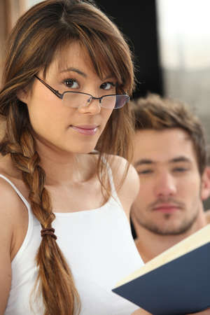 Woman with glasses reading photo