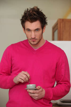 having a break: Young man with cup of coffee