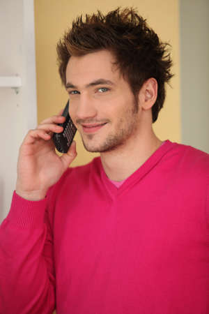Young man talking on the phone Stock Photo - 14019884