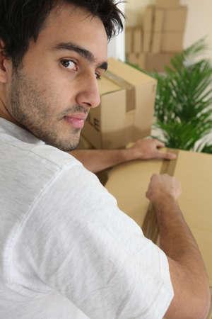 Man packing moving box photo
