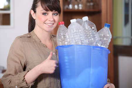 degradable: Woman recycling plastic bottles Stock Photo