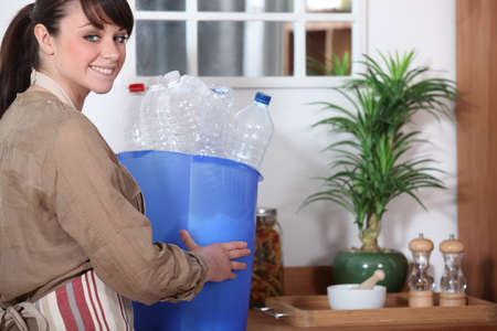 Woman with plastic bottle for recycling photo