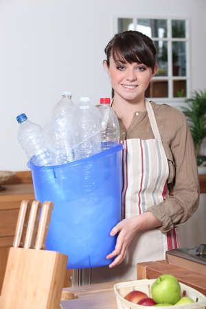 Woman taking out the recycling photo