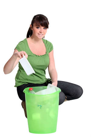 Woman recycling plastic photo