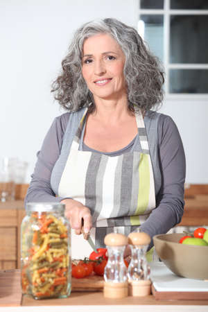 mature woman cooking photo