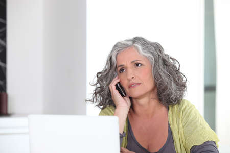Grey-haired lady embracing the digital age photo