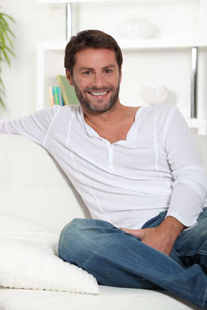 Young smiling on white sofa photo