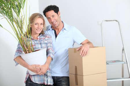 settling: Couple settling in the house Stock Photo
