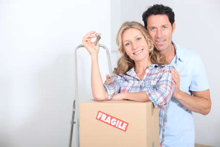 Couple with the keys of new flat photo