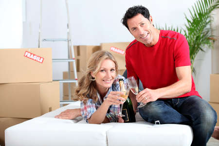 champagne toast: Celebrating the new house Stock Photo