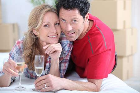 newlyweds celebrating new home photo