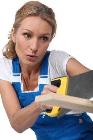 sawing: Woman sawing