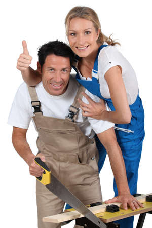 Couple stood by work bench doing home improvements photo