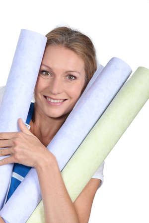 look pleased: Woman with wallpaper Stock Photo