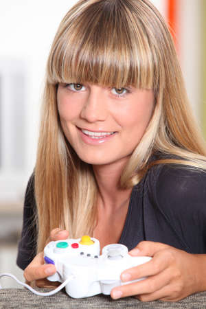exclaiming: girl playing video games Stock Photo