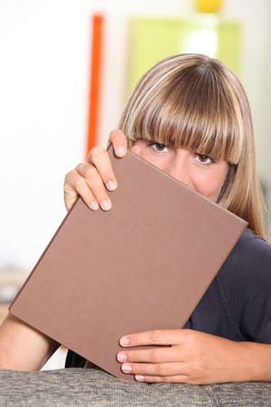 endorsed: Woman covering her face with folder