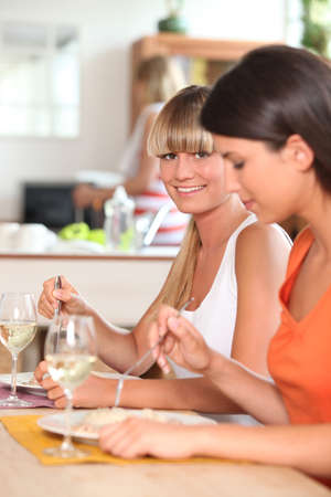 Women eating dinner together photo