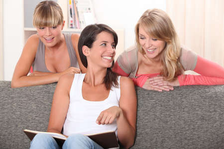 roommates: Roommates in their living room Stock Photo