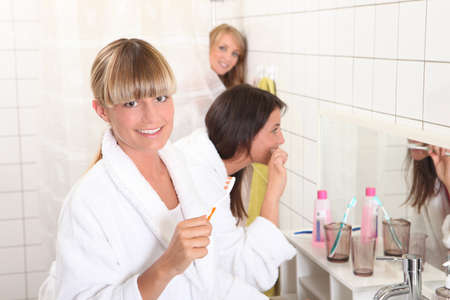 Three housemates in bathroom photo