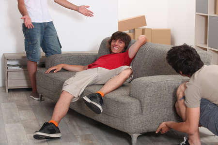 Three men arranging furniture photo