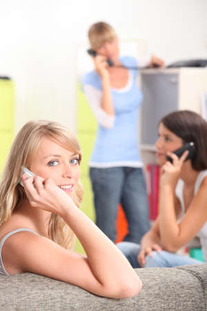 Young women making calls Stock Photo - 13958850