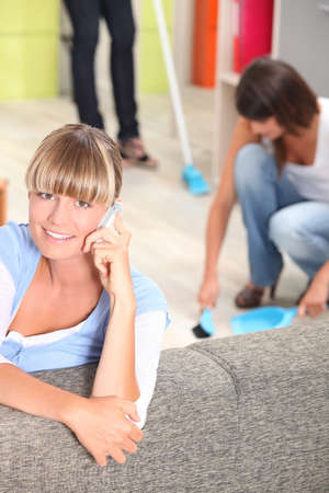 Women at home tidying Stock Photo - 14028218