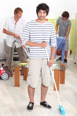 roommates: Young men doing chores Stock Photo