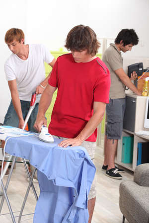 Young men doing their household chores photo