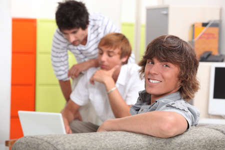 supported: Three boys in the classroom Stock Photo