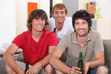 Flatmates enjoying a beer together photo