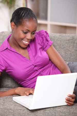 chat online: Black woman with sofa on couch