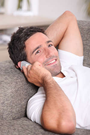 Closeup of a man talking on the telephone at home photo
