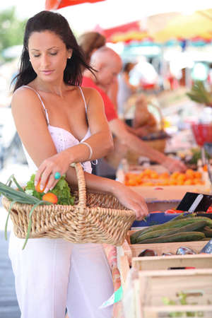 weekly market: Woman shopping at local market