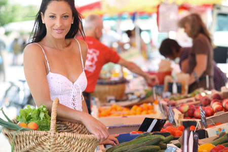 farmers market: Woman shopping at an outdoor market Stock Photo