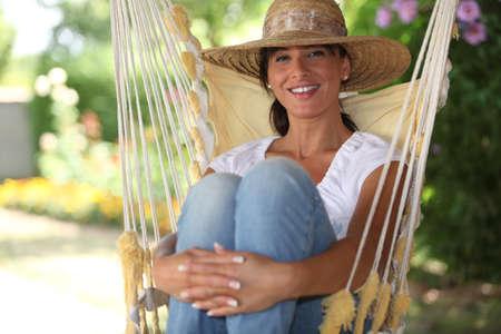 Woman sat in a hammock photo