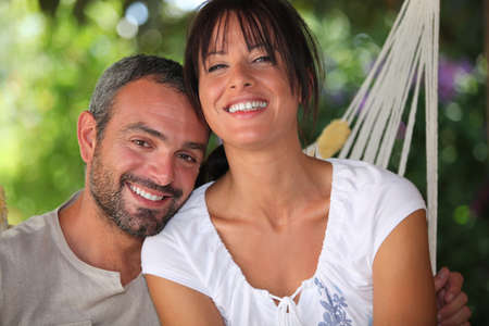 everyday people: Couple in hammock Stock Photo