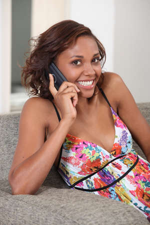 Young woman smiling on the phone Stock Photo - 14027742