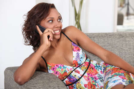 Sexy woman talking on her mobile phone photo