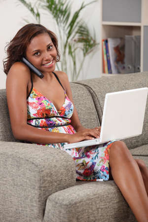 Woman with telephone and computer photo