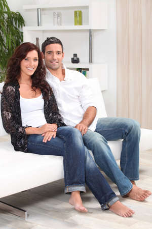 A nice couple on their sofa. Stock Photo - 13958567