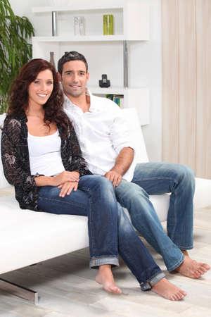 A nice couple on their sofa. Stock Photo - 13958567