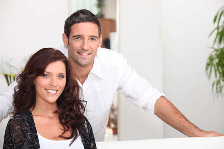 Classy couple in their living room Stock Photo - 13957966
